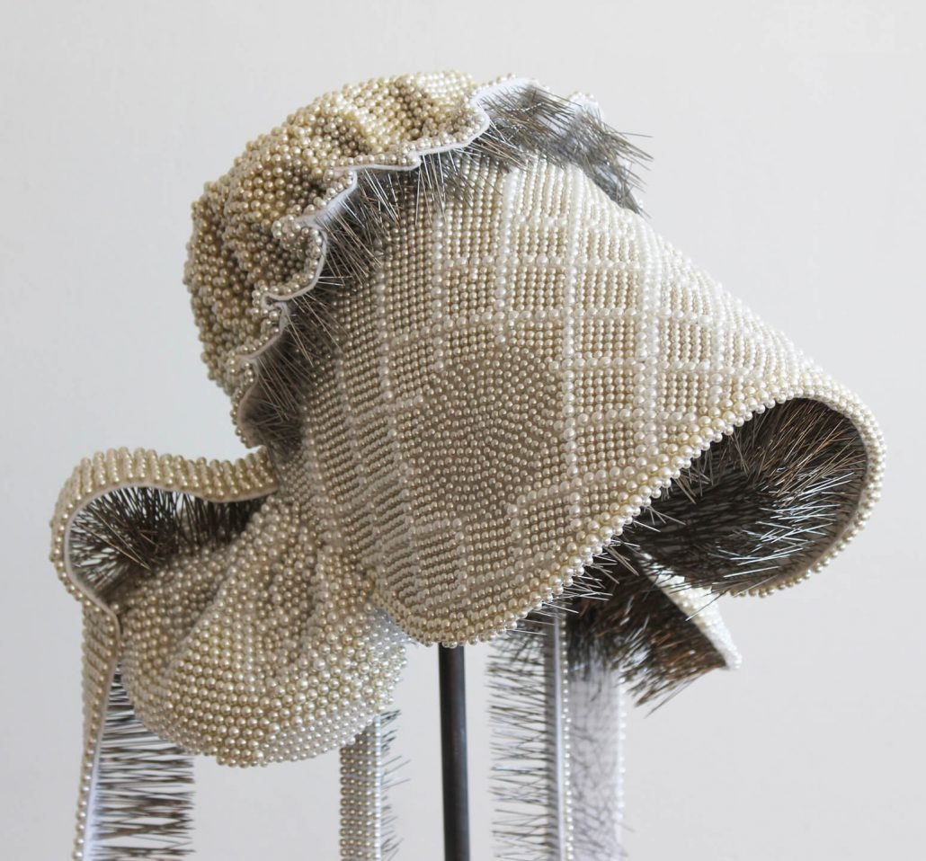 Angela Ellsworth - Seer Bonnet XIX (Flora Ann) (detail) (SOLD), 2011, 24,182 pearl corsage pins, fabric, steel, wood, 60 by 13 by 16 inches