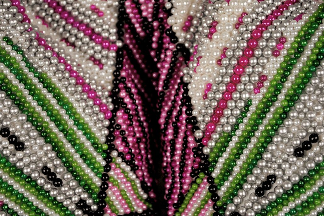 Angela Ellsworth - Pantaloncini: Work No. (indeterminate radiance) (Emma)(detail)(SOLD), 2017, 50,930 pearl corsage pins and colored dress pins, fabric, steel, 28 by 35 by 11 inches