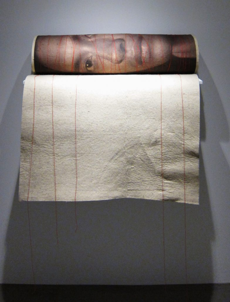 Luis González Palma - Mobius, 2014, photograph on felt, red thread, 40 by 30 inches approximately