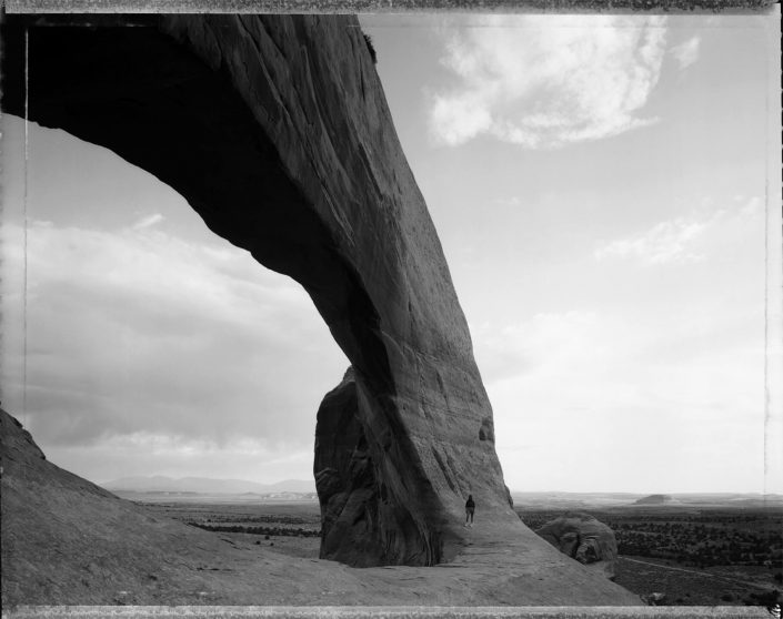 Mark Klett - Beneath the Great Arch, near Monticello, Utah, 6/21/82, 1982, gelatin silver print, 16 by 20 inches