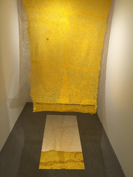 Neha Vedpathak - Nostalgia (installation), 2014, plucked Japanese handmade paper, jasmine scent, plexiglass mirror sheet, 108 by 60 inches (installation size: variable)
