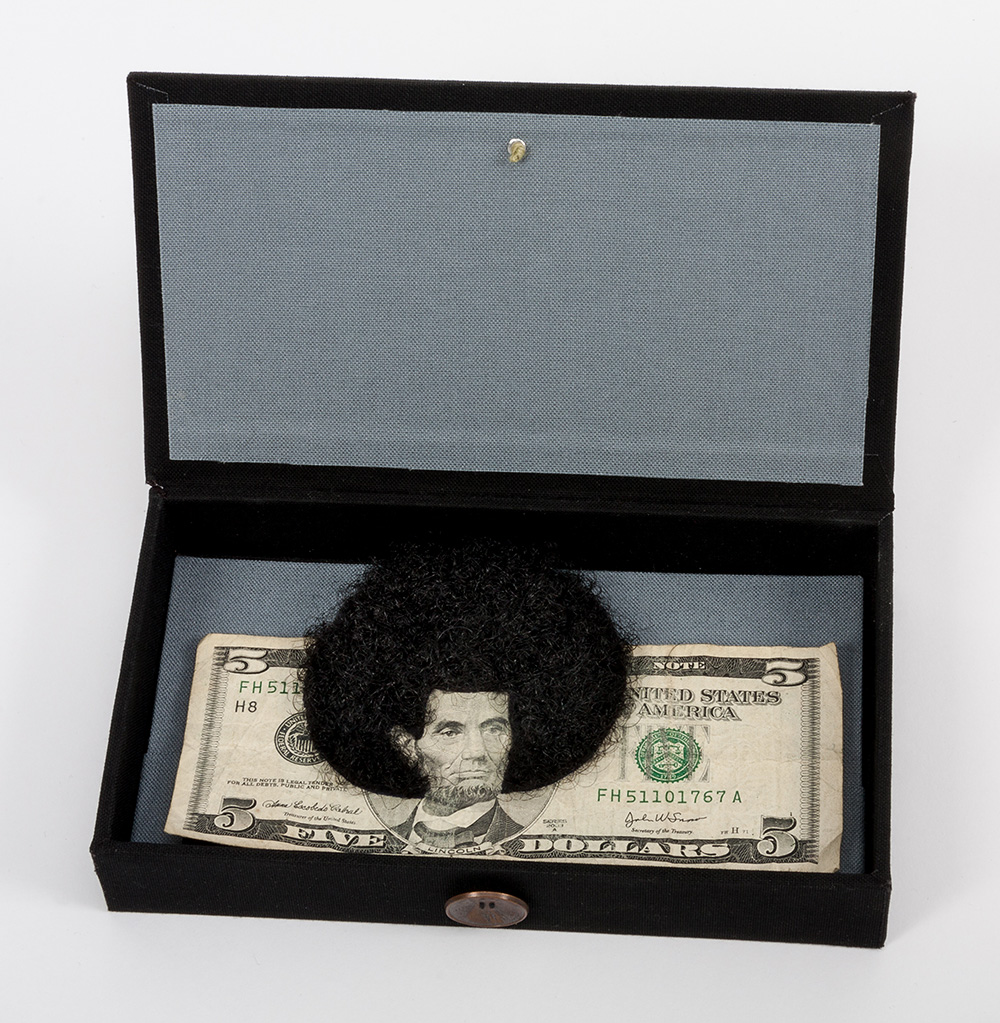 Sonya Clark - Afro Abe with Human Hair (SOLD), 2012, five dollar bill and artist's hair, handmade box, 3.5 by 6.125 inches, box dimensions: 4 by 7 by 1.25 inches