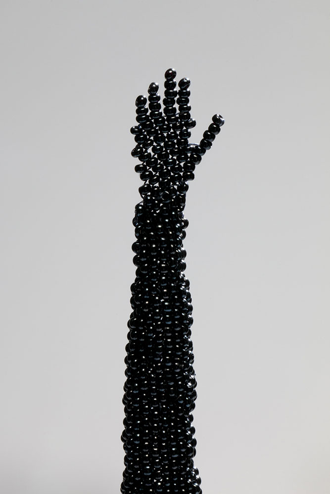 Sonya Clark - Reach 2 (detail), 2017, glass beads, 27.5 by 3.5 by 3.5 inches