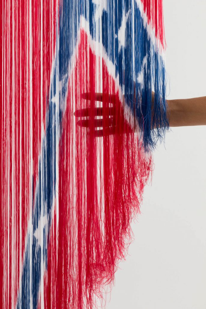 Sonya Clark - Untitled (detail), 2016, deconstructed nylon Confederate Battle Flag and flag pole, 104 by 24 by 8 inches