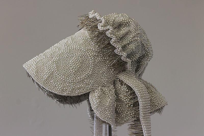 Angela Ellsworth - Seer Bonnet XXVIIII (Rhoda) (detail) (SOLD), 2015-2016, 19,136 pearl corsage pins, fabric, steel, 30 by 13 by 14 inches