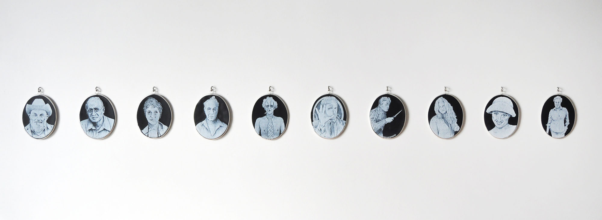 Charlotte Potter - Cameographic (installation view of 10 cameos), 2017, hand engraved glass, silver, tin, stainless steel, 5 by 4 inches each cameo, dimensions variable