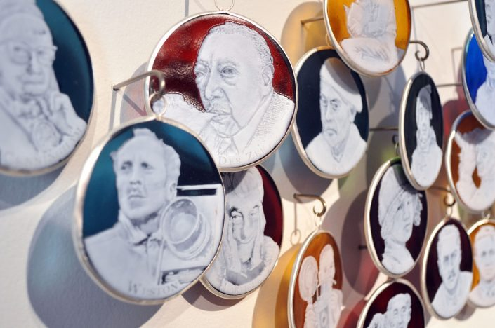 Charlotte Potter - Capturing Light: A History of Photographers (detail), 2017, hand engraved glass, silver, tin, stainless steel, 3 by 3 inches each cameo, approximately 13 feet long