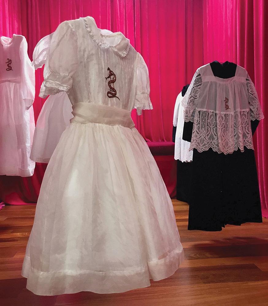 Trina MicKillen - The Children (detail), 2015-2018, 20 communion dresses, 20 altar boy vestments, Irish linen, thread, gold leaf, dimensions vary