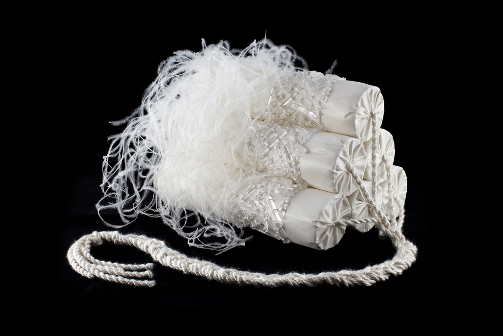 Mark Mitchell - This Lipsync Kills Fascists (SOLD), 2019, reed, cotton, wool, silk, Lumerian crystals, Black African ostrich feathers, 7.75 by 11 by 9 inches (not including fuse)