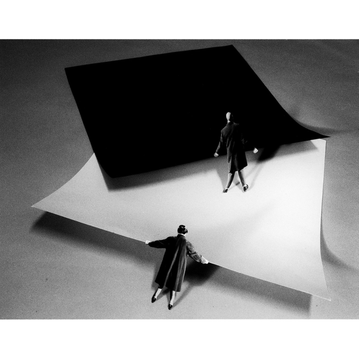 Gilbert Garcin - 309 - Le Yin et le Yang (ou les Malevitch choisissent un tapis)(Yin and Yang (or Malevitch's choose a carpet)), 2006, gelatin silver print, 12 by 8 inches, 16 by 12 inches, or 24 by 20 inches