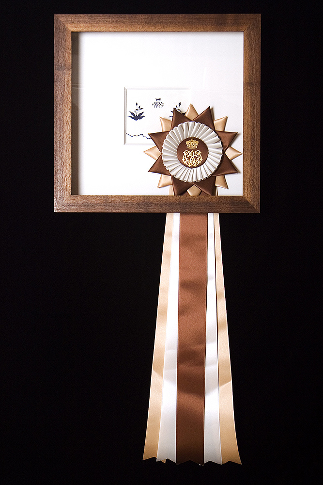 Carrie Marill - Duke and Duchess Series (SOLD): 1964: A navy and white embroidered appliqued linen bed set bearing the cipher of the Duchess of Windsor. c. 1960, paper, walnut, gouache and ribbon, 13.75 by 14.5 inches framed, not including ribbon