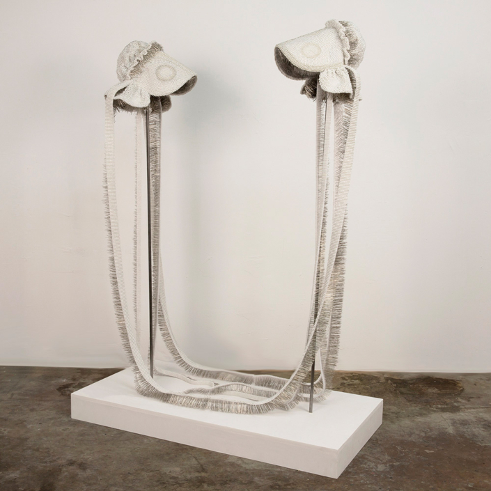 Angela Ellsworth - Seer Bonnet XXIV (Sister Sarah) and Seer Bonnet XXV (Sister Maria), 2016, 33,407 pearl corsage pins, fabric, steel, 65 by 48 by 24 inches