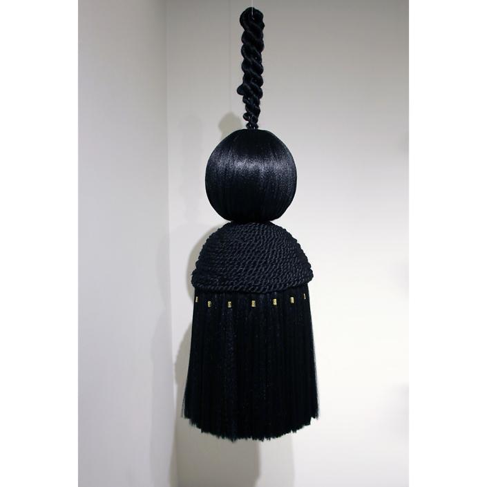 Merryn Omotayo Alaka & Sam Fresquez - Bundles Bundles II, 2021, Kanekalon hair, braid clamps, foam, 47 by 16 by 16 inches