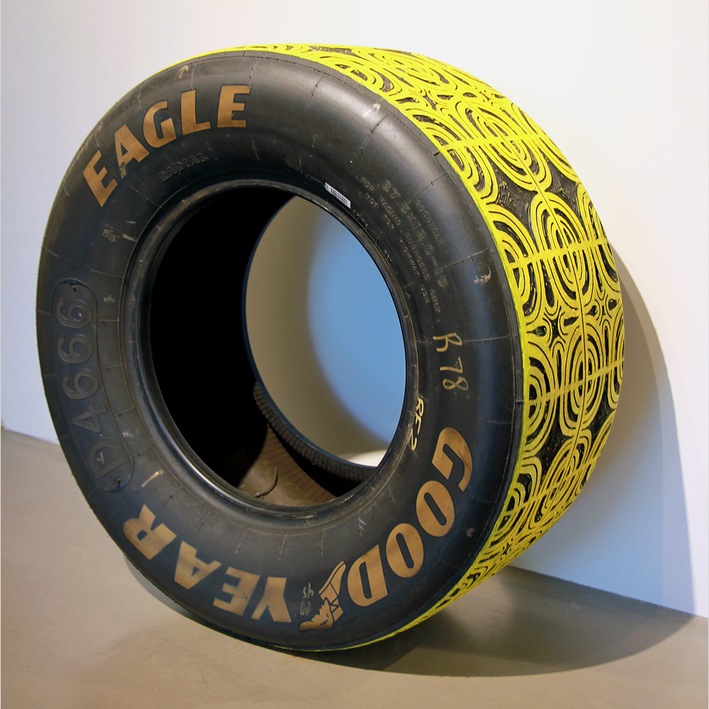 Sam Fresquez - Second Place is the First Loser, 2021, hand carved stock car tire, acrylic, 27.5 diameter by 12 inches